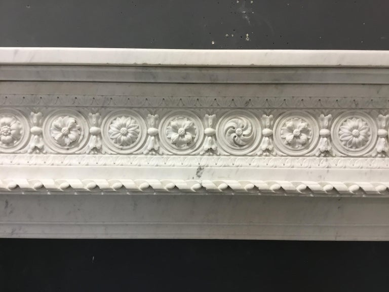 Carved An antique Louis XVI style chimneypiece  For Sale
