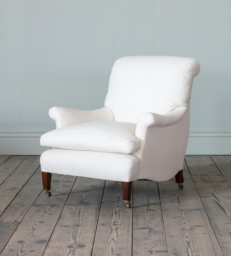 With sack back upholstery and outscrolled arms, the Millicent chair is based on an early 19th century Howard and Sons model.