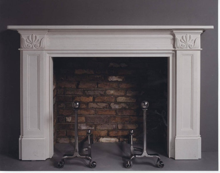The classical moulded and panelled elements of this chimneypiece are enriched with Greek and Roman influences and further decorated with lotus leaves and anthemia.
