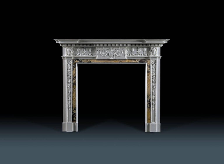 The intricately carved decoration on this chimneypiece illustrates Robert Adam's repertoire of neoclassical motifs and his characteristic delicacy. Adam's aim, in his own words, was 'to transfuse the beautiful spirit of antiquity with novelty and