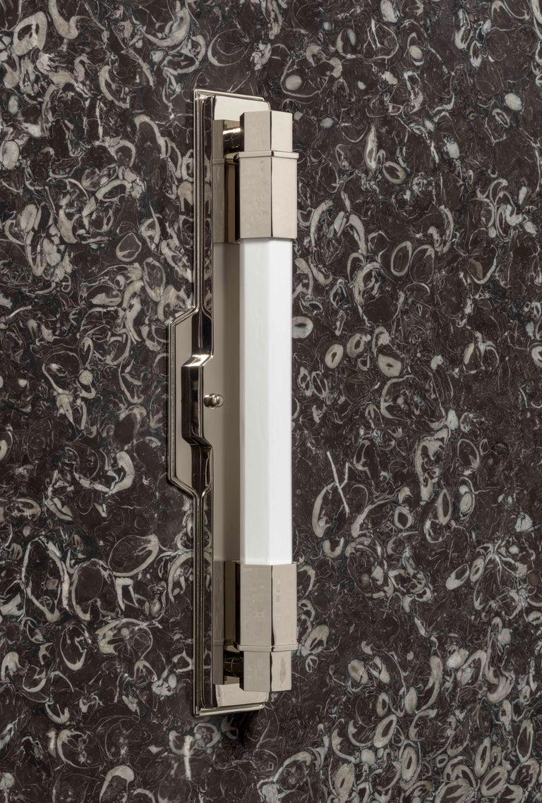 The Conroy is a heavy brass fixture with a hand crafted central opaline glass shade that is of staggering quality. Finished in Nickel with a backplate for the US. The Light is suited to many varied locations but is UL damp listed for bathroom use as