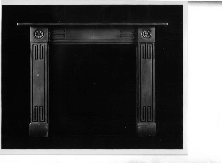 "An unusual 19th century Welsh slate Regency ""Greek-Revival"" chimneypiece. The frieze and jambs are decorated with recessed Greek key motifs and the end-blocks with stiff leaf paterae, circa 1820."