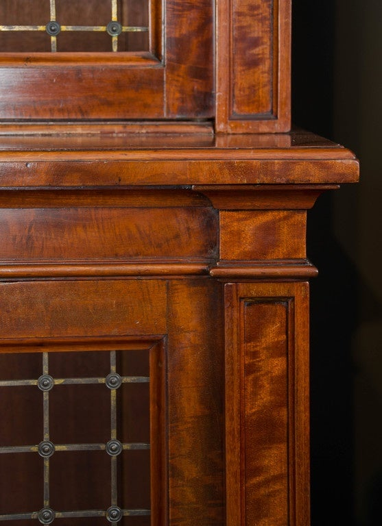 Bookcases with grill doors on plinth bases, English, circa 1835.