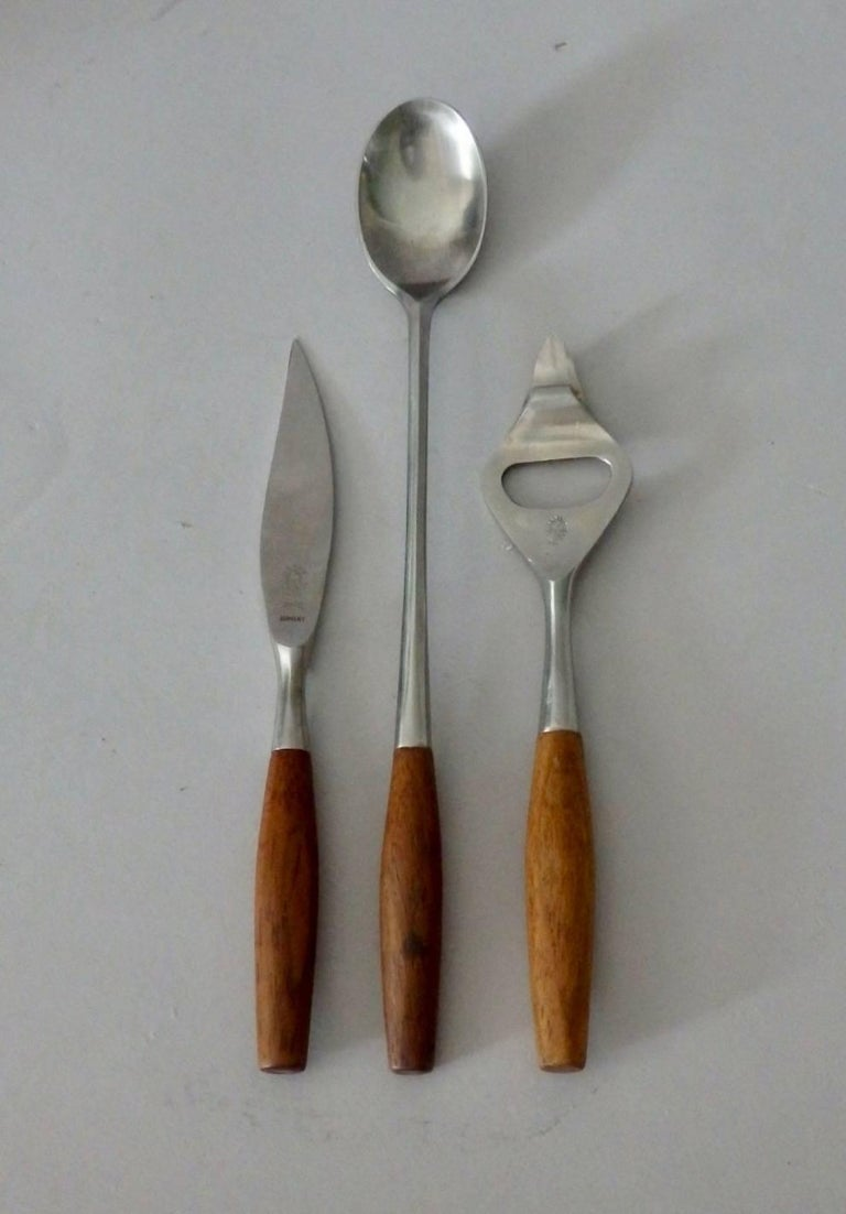 Teak handled three-piece stainless steel bar set. Bottle / can opener, stirring spoon, fruit knife. Marked with Dansk early three duck logo JHQ . Very nice condition.