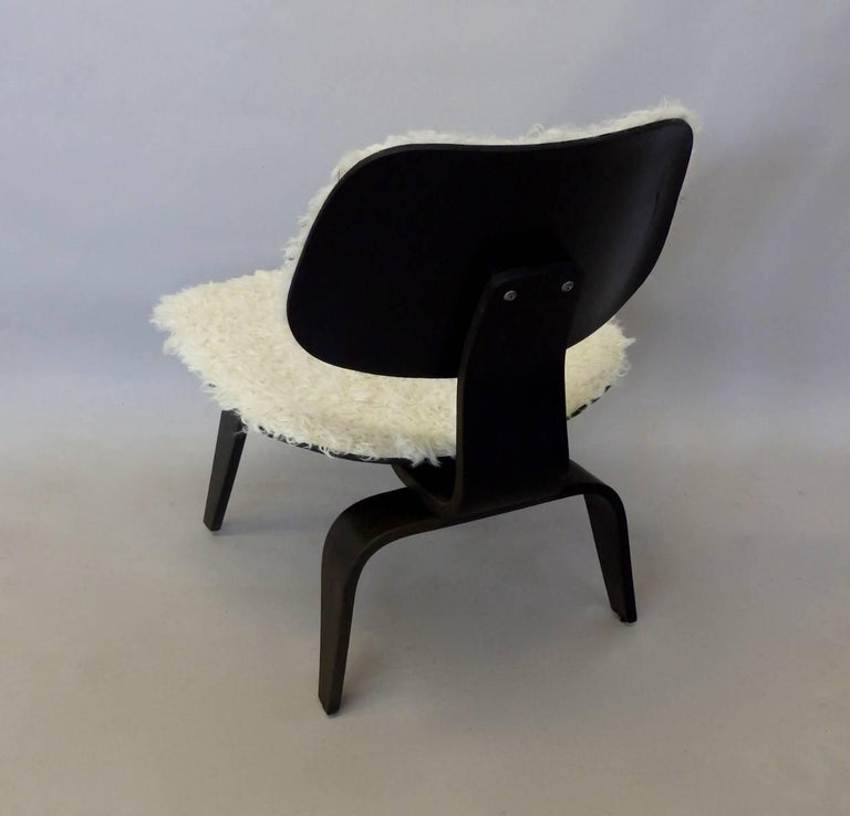 Very nice Charles and Ray Eames ebonized lounge chair wood legs LCW  for Herman Miller . Covered in lambskin hide . Earlier chair with foil label .