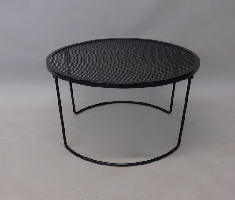 Art Deco style Russell Woodard coffee or cocktail table. Base folds under the table. Recently powder coated and excellent. Shipping quote shown is very high. With the table folded the price should come down.