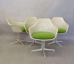 Four Burke white fiberglass swivel dining chairs