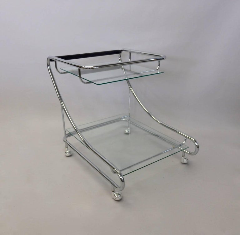Very nice 1970s drinks cart. Upper and lower glass shelf in tubular chrome frame. Excellent condition all around.