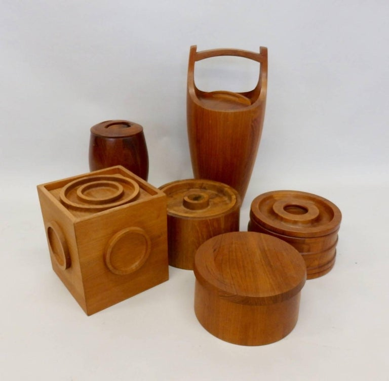 All five Danish teak ice buckets are Dansk designed by Jens Quistgaard. All five are made in Denmark. All five in very good condition age shows as patina.
