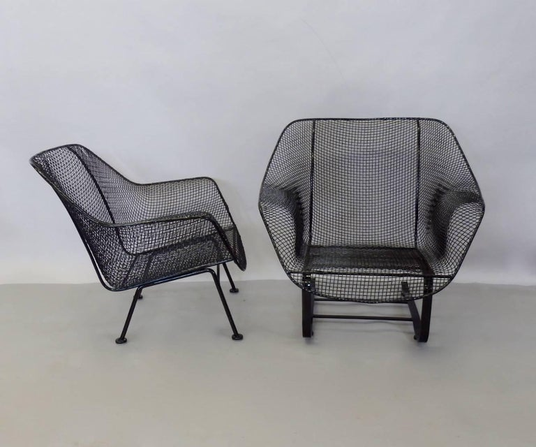 Pair of Woodard large lounge chairs. One springer base one straight leg. Both chairs recently stripped and powder coated in gloss black finish. New glides added to each base.