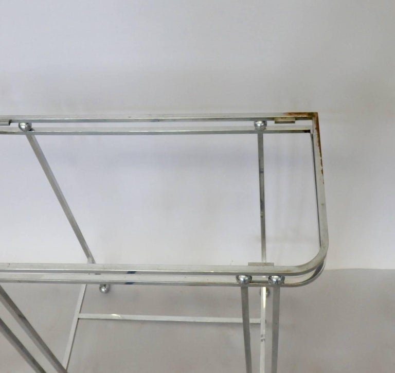Square stock solid chrome steel frame with chrome brass ball embellishment. Original chrome shows wear and pitting.