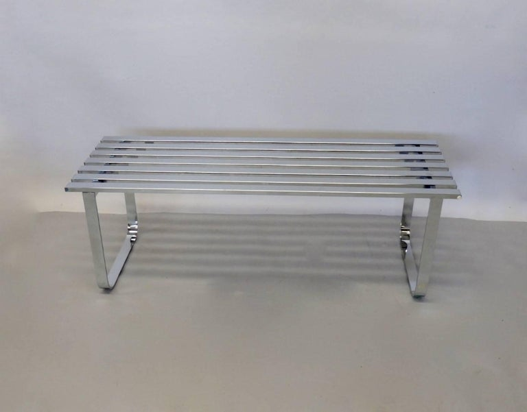 Milo Baughman for Design Institute America. Chrome slat bench with chrome legs. Nice condition. Top surface shows wear from everyday use. There is one tiny ding on one slat. I could not get it to show in images.
