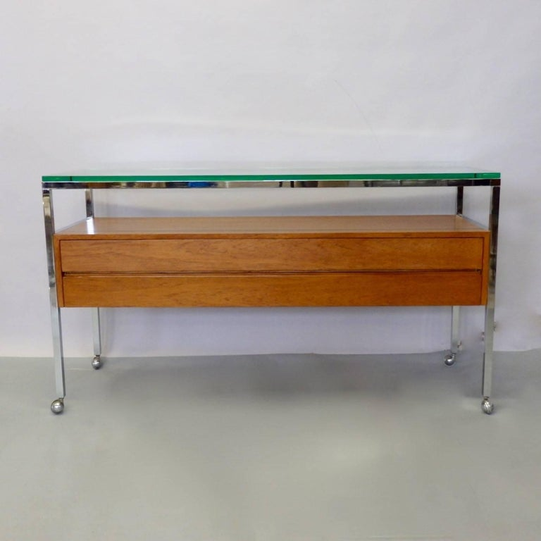 Chrome frame credenza with teak wood cabinet and glass top. Believed to be custom piece by Florence Knoll for Knoll.