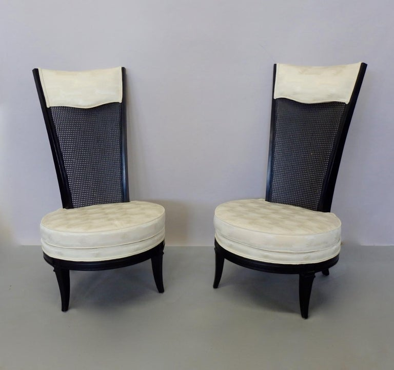 Black lacquer frames with white upholstery on seat and over black lacquered cane backrest. Very clean fresh estate decorator chairs.