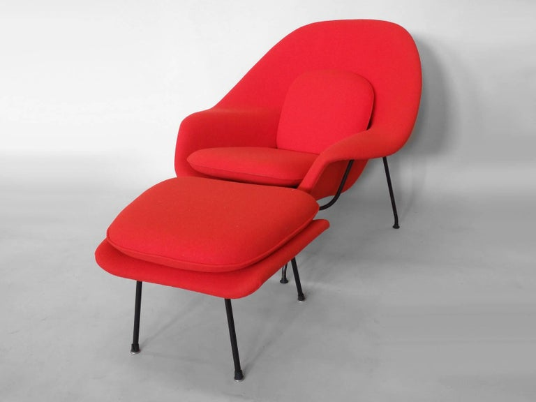 """Eero Saarinen for Knoll. Shell has been re-foamed and correctly upholstered in period syle Maharam Kvadrat wool textile. Black frame powder coated new glides have been added. Measures: Chair: 40"""" wide x 31"""" deep x 35.5"""" tall. Ottoman: 20"""" deep x"""