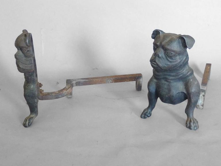 Early cast iron bulldog andirons, first half 20th century.