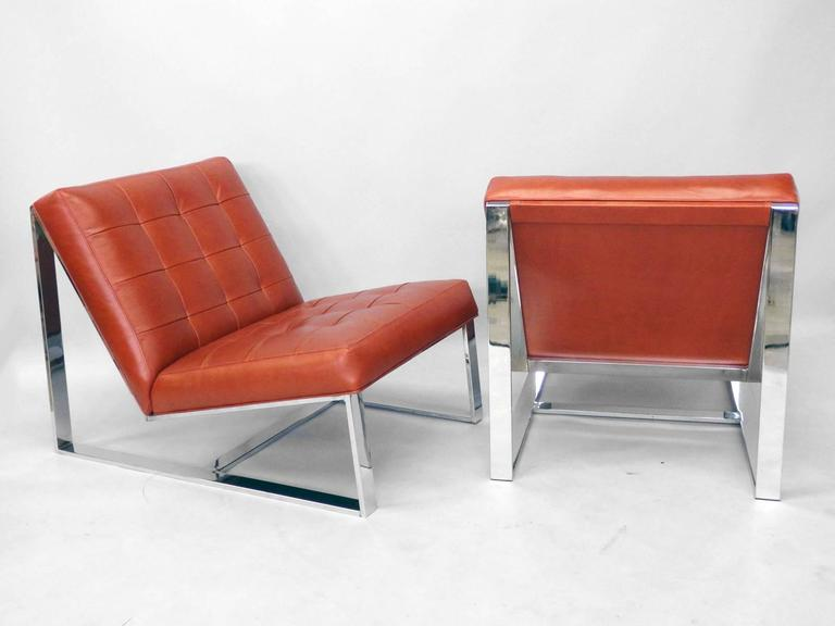 Milo Baughman for Thayer Coggin lounge chairs  recently upholstered in soft supple red leather .