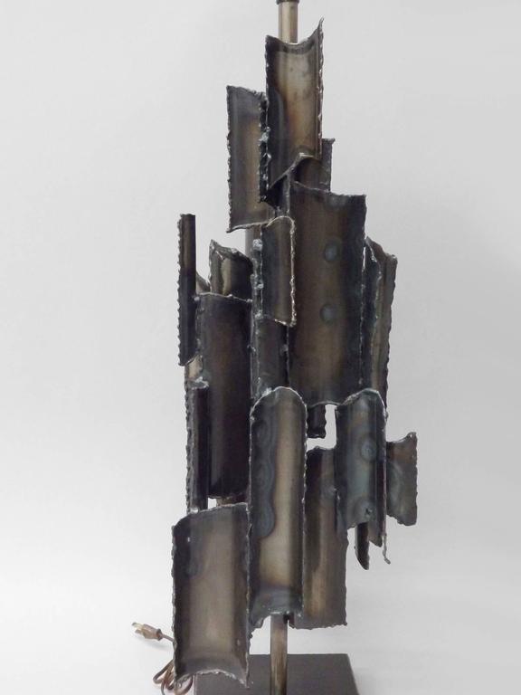 Torch cut Brutalist Marcello Fantoni table lamp. Marked Marcello Fantoni, Italy.