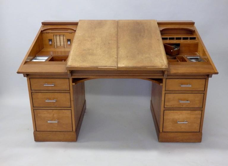 Custom Built Art Deco desk attributed to Johann Tapp of Chicago . Built for Chicago Tribune Pulitzer prize winning cartoonist Carey Orr. Both top side panels flip inward to create drafting workspace. Sliding doors reveal multiple compartments