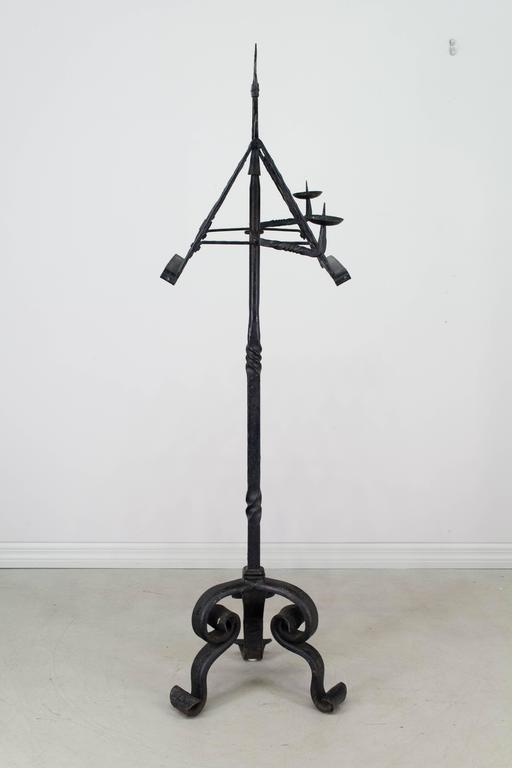 19th century French wrought iron lectern with Fleur de Lys decoration. Heavy three leg base. Removable, double-sided pivoting book stand with candleholders on each side. Excellent craftsmanship with banded construction. A nice decorative music or