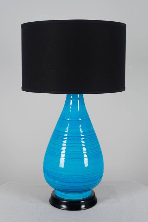 Pair of large Mid-Century Modern Frederick cooper bright blue pottery lamps, each with beautiful color and crackle glaze. Rewired with new brass three-way sockets. Photo of old socket shows the original manufacture label, circa 1950-1960. These