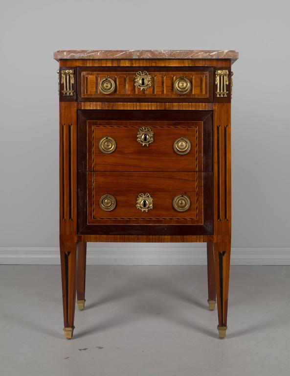 A fine 18th century Louis XVI petite marquetry commode by Parisian ebeniste (cabinet maker), Martin Ohneberg (b. Germany 1738). Beautiful inlay of mahogany, walnut and tulip wood with French polish finish. Oak as a secondary wood. Three dovetailed