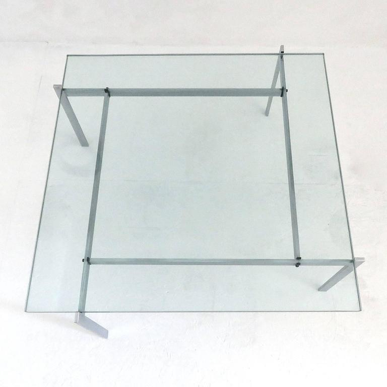 Iconic early version PK-61 coffee table, designed by Poul Kjærholm, 1969 for E. Kold Christensen, Denmark, 1956-1981 in brushed, chromium-plated steel with glass top, marked with EKC logo.