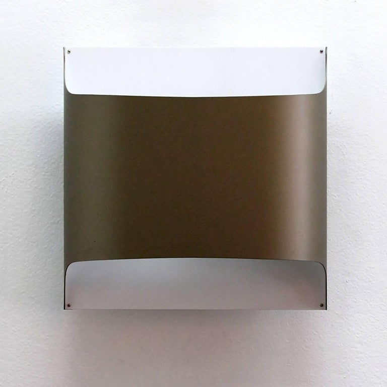 Minimalist folded metal wall lights by Staff of Germany in ivory-white and near bronze-brown color, can be used as flush mount ceiling lights as well. Designed by R. Kruger & D. Witte in 1968.
