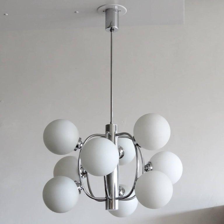 Stunning 1970s German chandelier by Hustadt Leuchten, with nine opaline glass globes around an atomic chrome frame work.