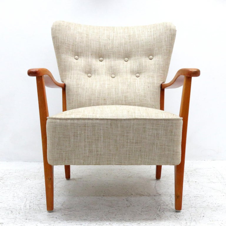 Wonderful Danish modern armchair by DUX, 1940, sculptural stained beech frame with professionally reupholstered body, The concave back is tufted and the seat is spring supported, with detachable head rest cushion, marked. (see also LU848711949441
