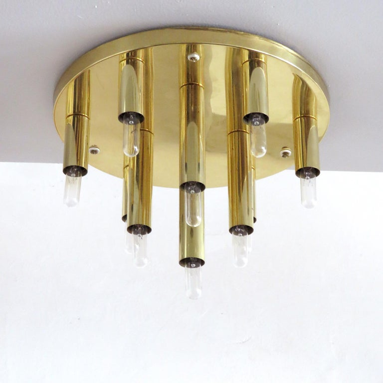 stunning circular ten-light flush mount light panel in brass by Soelken Germany, can be used as wall light as well.