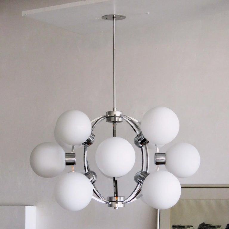 Stunning 1970s German chandelier by Hustadt Leuchten, with twelve opaline glass globes around an atomic chrome frame work. Current total drop is 31.5