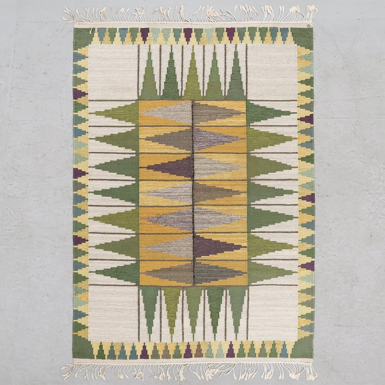 Wonderful, vintage Swedish flat-weave rug with geometric compositions in shades of green, beige and yellow. Signed TV.