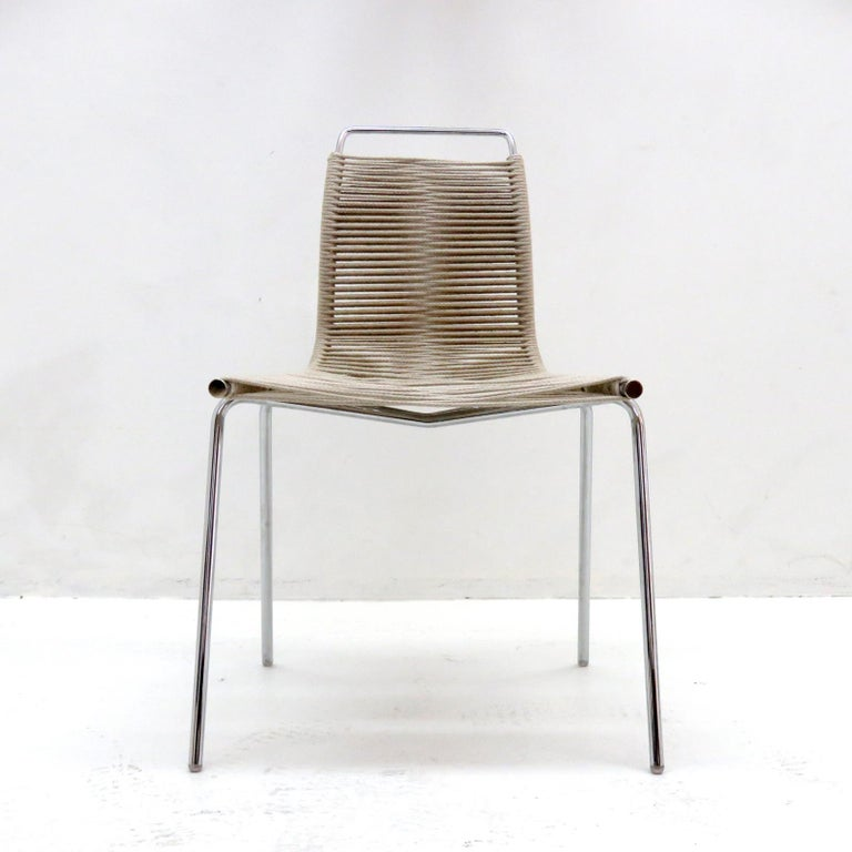wonderful dining chair PK-1, designed by Poul Kjærholm in 1955, in chrome plated tubular steel with flag halyard.