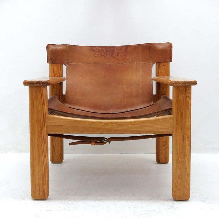 Bold and comfortable Danish modern lounge chair by Karin Mobring, Sweden, designed in 1977, oversized pine frame with thick cognac colored leather with incredible patina.