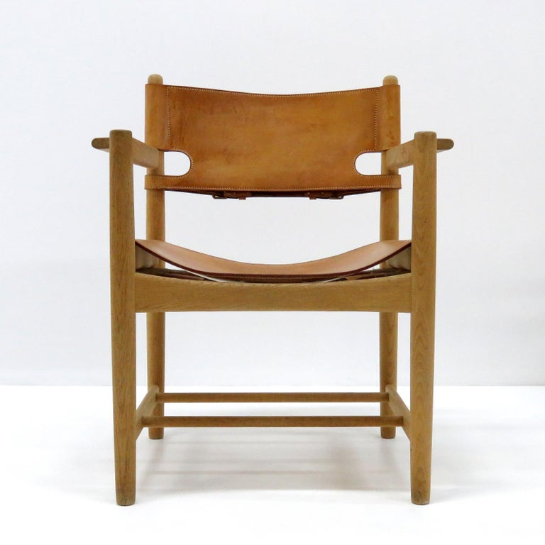 Wonderful pair of Børge Mogensen 'Hunting' chairs, model no. 3238 for Fredericia Furniture, with saddle leather on oak frames, great patina, part of a set of 10 chairs, partially marked.