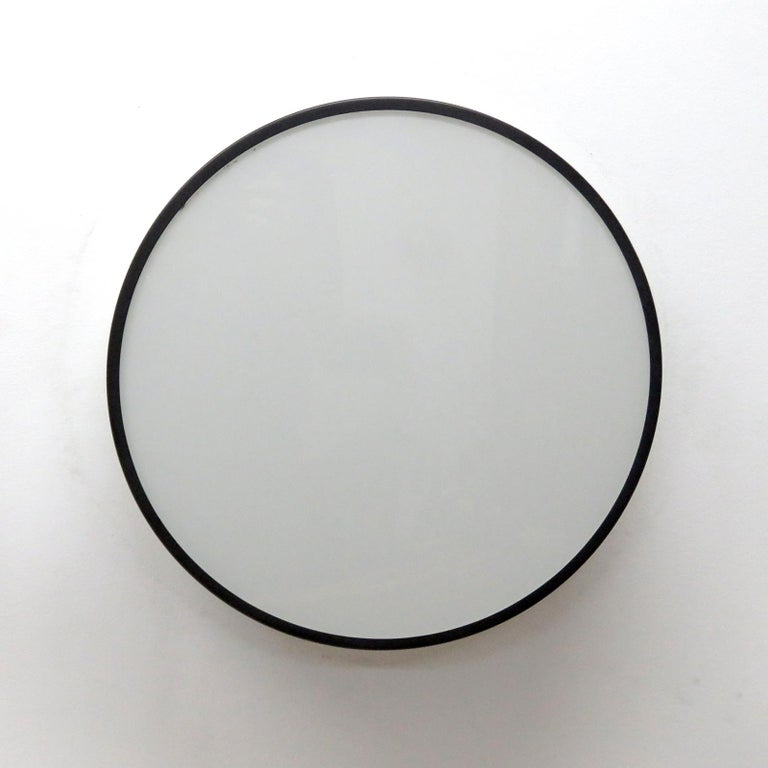 Stunning circular flush mount lights 'Lundofte' by Kay Boeck-Hansen & Jørgen Stærmose for Lyfa, 1972, in dark blue metal with white glass diffuser and white glass ring for additional back lighting, can be used as wall or ceiling lights.