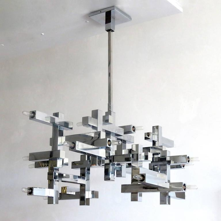 "Stunning extra large ""Metric"" chandelier by Gaetano Sciolari, Italy, 1960, in chrome-plated steel, eighteen sockets, great condition, fully original with optional 9"" rod extension for an overall height of 45"", marked."