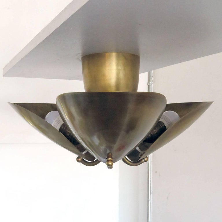 Wonderful, organic three-petal patinaed brass flush mount by Gallery L7.