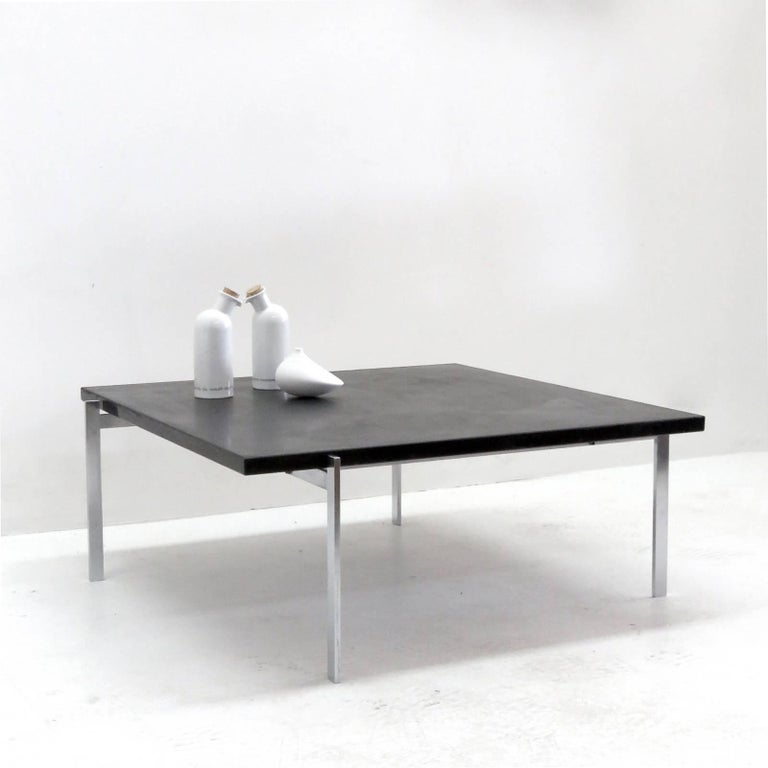 Iconic early version PK-61 coffee table, designed by Poul Kjærholm, 1969 for E. Kold Christensen, Denmark, 1956-1981 in brushed, chromium-plated steel with a slate top, marked with EKC logo.