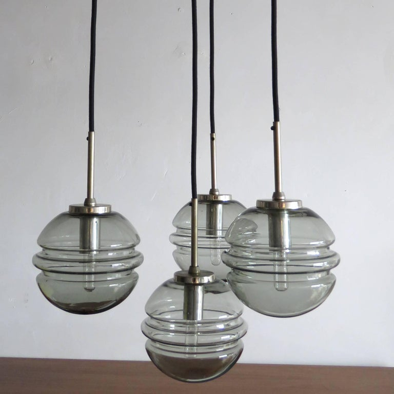 Smoked Glass Four Globe Hanging Fixture In Excellent Condition For Sale In Los Angeles, CA