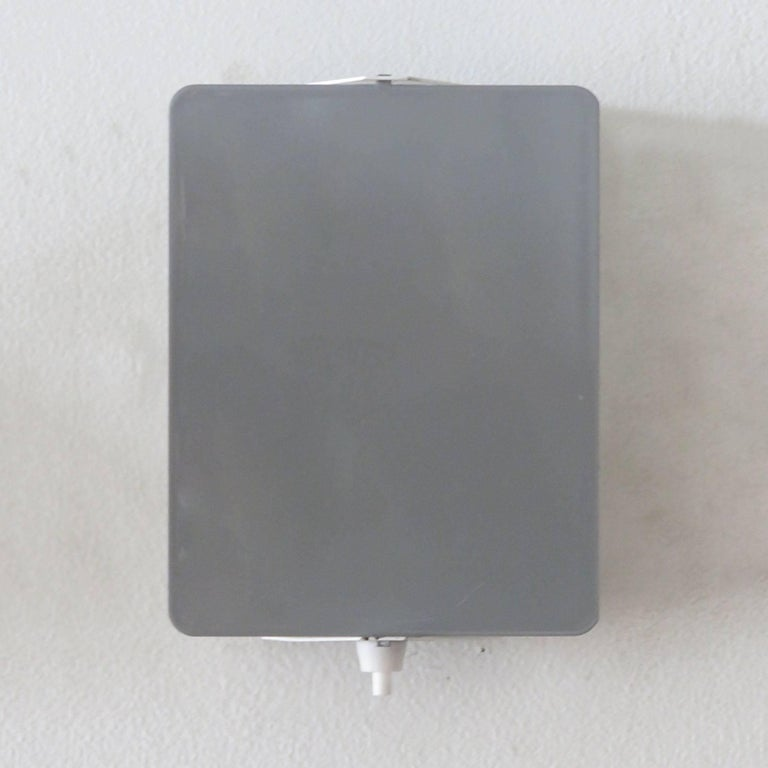 Iconic enameled wall lights by Charlotte Perriand with adjustable reflectors in rare grey finish, optional horizontal or vertical mount, manufactured and distributed by Steph Simon, Paris, marked.
