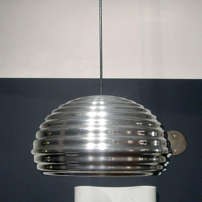 original Splu¨gen Brau hanging lights by Achille Castiglioni, polished aluminum, de-lacquered and hand polished], priced individually.