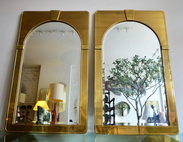Mastercraft pair of brush brass arched Palladian beveled wall mirrors.  Uber sophisticated stylized architectural detailing. Ultra thin profile. Finest quality.