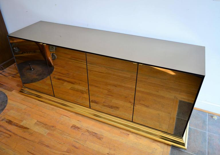 An elegant bronze tinted mirrored buffet by Ello.