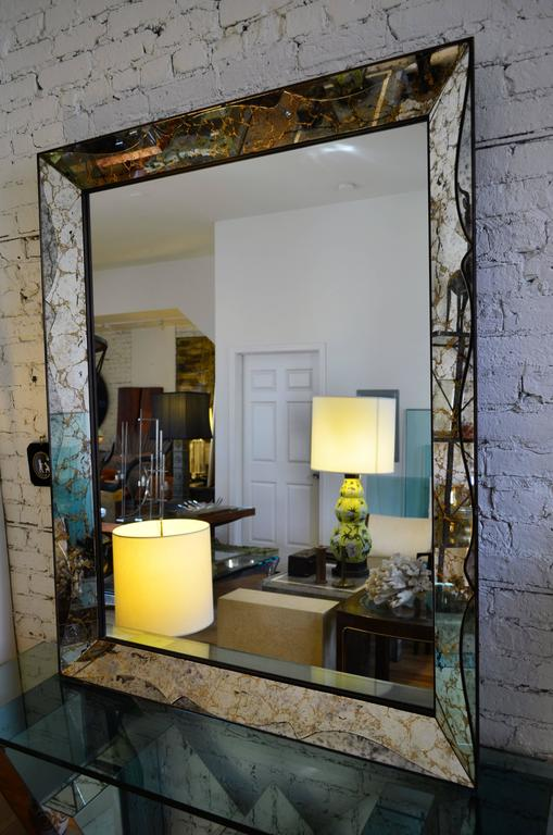 An extemely large smoked glass 1950s Venetian mirror. The mirrored border is richly veined.