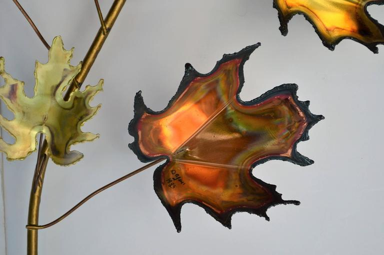 Two sprays of Brutalist maple and copper maple leaf wall decorations.