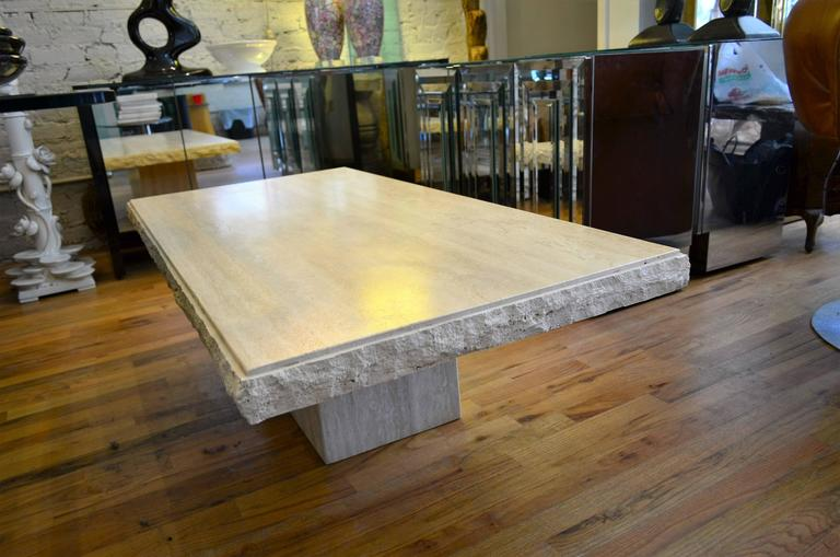 A large Mid-Century polished travertine coffee table.