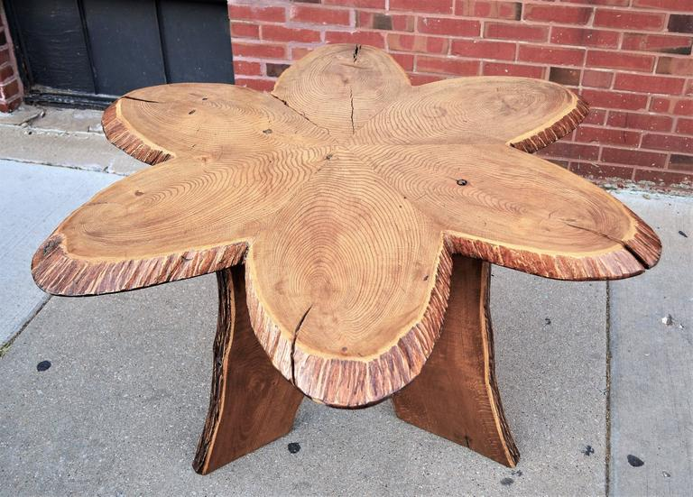 Oak Andironack table.One of a kind six petal folk art table. Undoubtedly commissioned by a master craftsman. Six oak slabs rest on a wood tripod base. There is a separation between two of the top slabs. Please see images. Given its versatile size