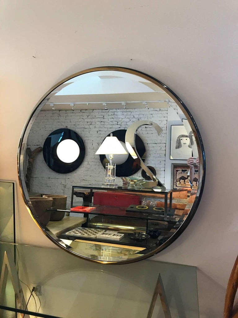 Round monumental gunmetal and brass beveled mirror designed by J Wade Beam for Brueton. The large  mirror is has a seamless metal frame with an ogee profile.